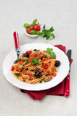 fusilli with tomato olives and oregano
