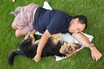 Man Sleeping Embraced With His Dog