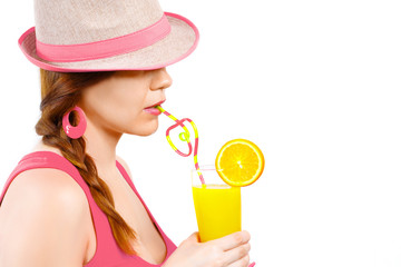 Girl drinking orange juice on white background