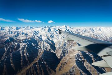 plane wing snow mountain view