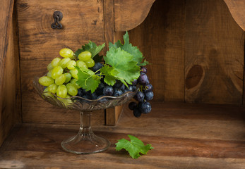 Bunch of green and red grapes in vase for fruits