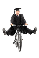 Overjoyed graduate student riding a bike
