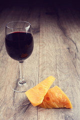 Cheese on the table with glass of wine