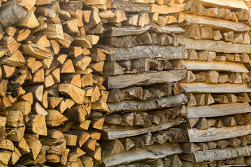 Pile of different chopped firewood prepared for winter