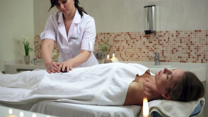 Woman enjoying stone therapy