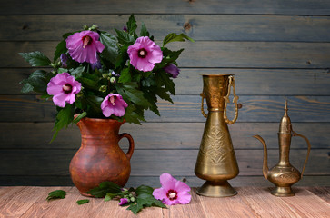 Purple hibiscus in a ceramic vase