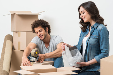 Couple Packing Cardboard Box