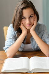 Teenage girl enjoy reading book at home