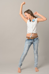 Teenage girl dancing singing enjoy music
