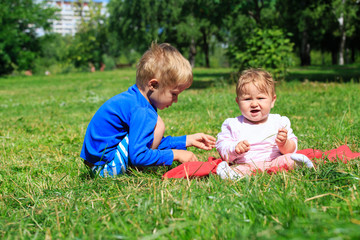 kids playing in summer park