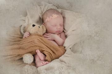 Schlafendes Baby mit Bärchen