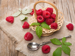 Fresh organic raspberry in basket