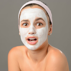 Surprised teenage girl looking camera face mask