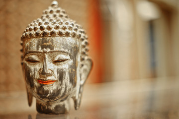 Peaceful Buddha head on table of souvenir shop