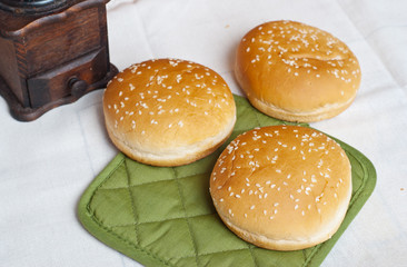 Three round sandwich bun with sesame seeds