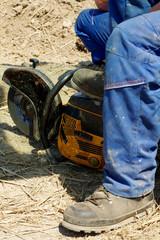 worker cutting steel tool