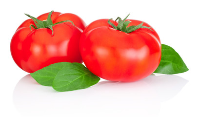 Two red tomatoes and leaves isolated on a white background