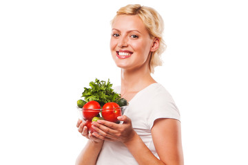 Close-up of healthy smiling woman holding fresh vegetable salad