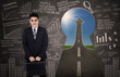 Asian businessman standing in front of keyhole
