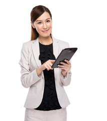 Young business woman using tablet on white background