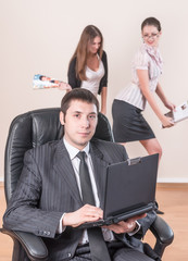 Businessman with laptop works in office