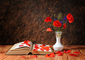 Poppies in a vase and books