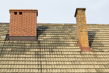 two brick chimneys on the roof