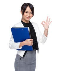 Asian business woman holding chip board with ok sign on white ba