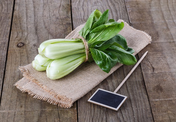 Bock Choy on a rustic wooden background