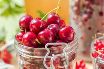 Summer fruits closeup cherries jar processed
