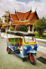 Tuk Tuk taxi in front of a temple