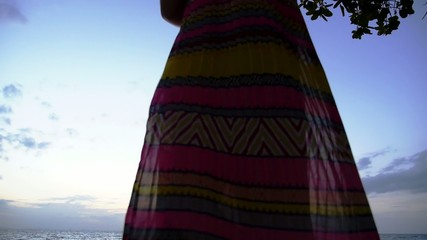 Woman in Long Dress Using Smartphone at the Beach. Slow Motion.