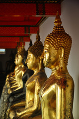 Golden Statues in a temple in Thailand