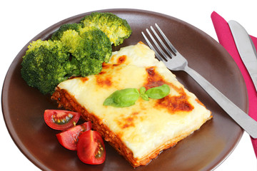 Lasagne bolognese on white background