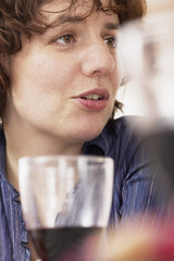 Smiling happy woman drinking with friends