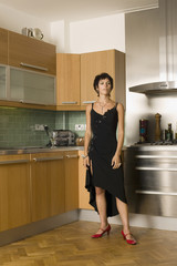 angry woman fuming in kitchen
