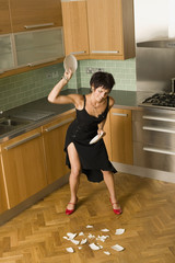 angry woman smashing plates