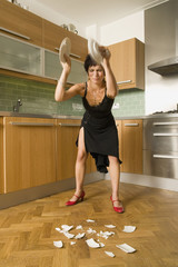 angry woman smashing plates Young-adult woman, 20-29 years,