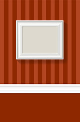 Empty white picture frame on a striped wallpaper