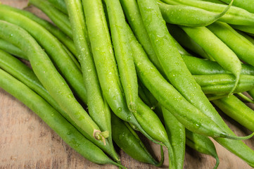 Fresh snap or green beans on a table
