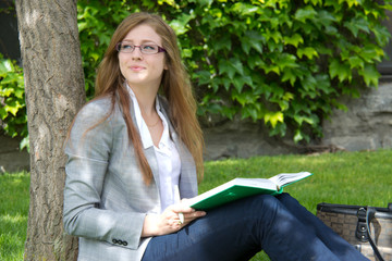 Female college student studies outside on campus