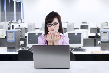 Businesswoman praying while working 1