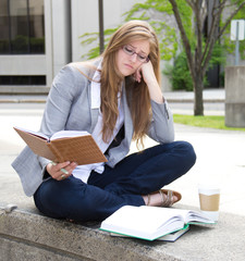 Stressed student studying on campus