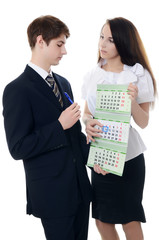 The businessman and businesswoman hold calendar