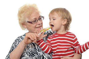 The elderly woman with little grandson