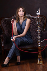 The beautiful woman with a hookah