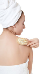 The beautiful woman with a massage brush. SPA concept.