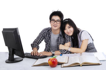 Cheerful students studying together