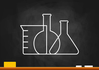 Laboratory glass on blackboard