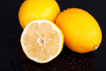 Lemons on wet table